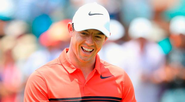 Rory McIlroy of Northern Ireland smiles on his last hole during the first round of the BMW South African Championship at Glendower Golf Club on January 12, 2017 in Johannesburg, South Africa. (Photo by Warren Little/Getty Images)
