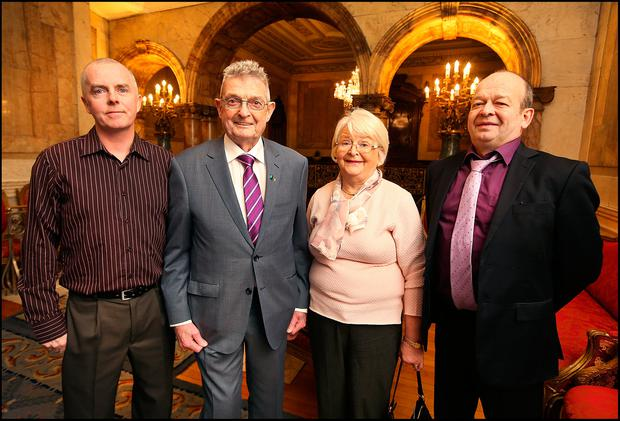 Ted Moynihan who was announced as Kerry Person of the Year at Iveagh House in Dublin is pictured with his wife Breda and sons Teddy (left) and Simon. Pic Steve Humphreys