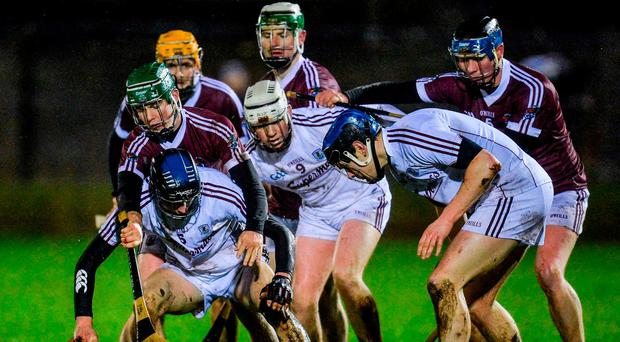 Sean Loftus of Galway in action against Ian Fox of NUI Galway, left, battle for the ball during the Bord na Mona Walsh Cup Group 1 Round 2 match between Galway and NUI Galway at Duggan park, Ballinasloe in Co Galway. Photo by Seb Daly/Sportsfile