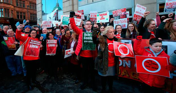 An Dream Dearg, a network of Irish language activists protest against cuts to Irish language bursaries, outside at the Department of Communities in Belfast. Photo: Niall Carson/PA Wire
