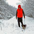 Senan Teevan and his dog Dougal take a walk in the snow in Snugborough, Ballyconnell, Co Cavan. Photo: Lorraine Teevan