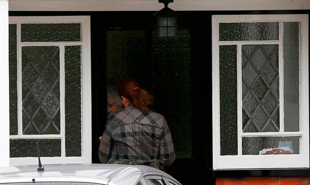 A woman arrives at an address which has been linked by local media to former British intelligence officer Christopher Steele, who has been named as the author of an intelligence dossier on President-elect Donald Trump, in Wokingham, Britain, January 12, 2016. REUTERS/Peter Nicholls
