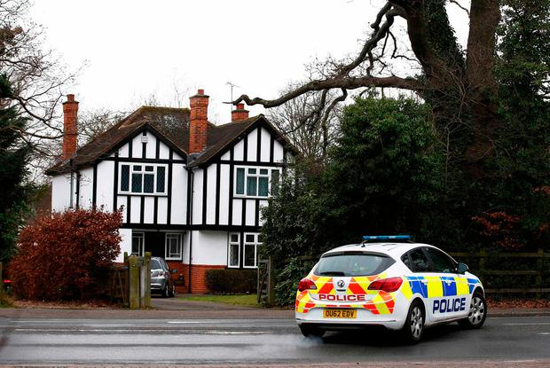 A police car drives past an address which has been linked by local media to former British intelligence officer Christopher Steele, who has been named as the author of an intelligence dossier on President-elect Donald Trump, in Wokingham, Britain, January 12, 2016. REUTERS/Peter Nicholls
