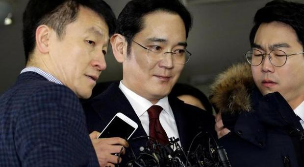 Jay Y. Lee arrives to be questioned as a suspect in bribery case