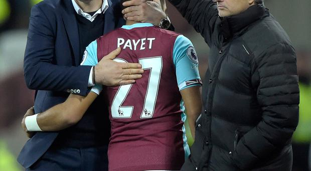 Dimitri Payet (C) of West Ham United is given a hug by manager Slaven Bilic