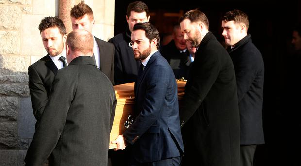 The coffin is carried from the Church of the Sacred Heart in Donnybrook after the funeral of TK Whitaker. Photo: Damien Eagers