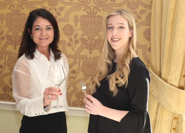 Amy Mulvaney with Orla Brosnan from the etiquette School of Ireland, the Etiquette School of Ireland hosted an Etiquette Masterclass at the Shelbourne Hotel today. Picture credit; Damien Eagers