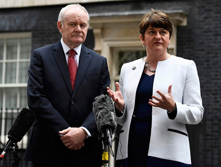Then Northern Ireland Deputy First Minister Martin McGuinness, of Sinn Féin, and First Minister Arlene Foster, of the DUP, pictured in October 2016. Mr McGuinness resigned on Monday Photo: Dylan Martinez/Reuters
