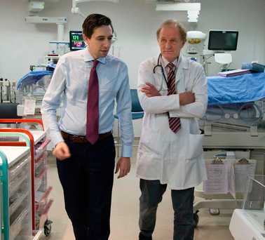Health Minister Simon Harris with Dr John Murphy at the National Maternity Hospital, Holles Street, Dublin Photo: Colin O'Riordan