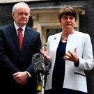 Arlene Foster and Martin McGuinness speak to journalists as they leave Number 10 Downing Street in London, last year. Photo: Dylan Martinez/Reuters