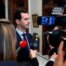 Syria's President Bashar al-Assad speaks to French journalists in Damascus, Syria, in a photo provided by the Sana agency. Photo: Reuters