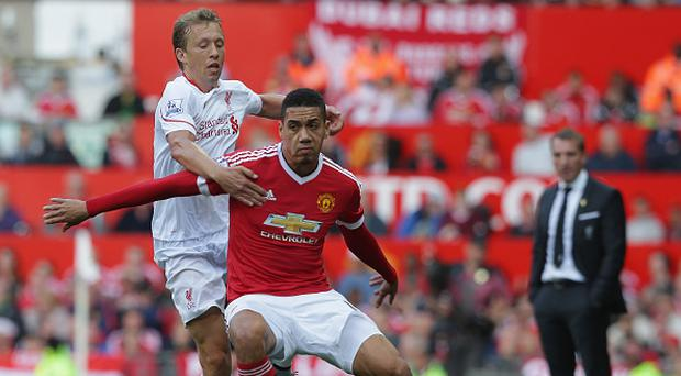 MANCHESTER, ENGLAND - SEPTEMBER 12: Chris Smalling of Manchester United in action with Lucas of Liverpool during the Barclays Premier League match between Manchester United and Liverpool at Old Trafford on September 12, 2015 in Manchester, United Kingdom. (Photo by John Peters/Man Utd via Getty Images)