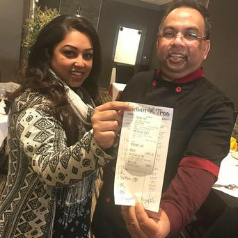 Staff at the Indian Tree in Portadown hold the tip for £1000. Photo Credit: Facebook Indian Tree