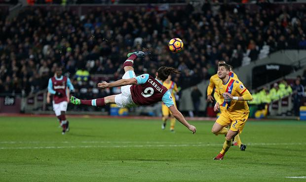 STRATFORD, ENGLAND - JANUARY 14: West Ham United's Andy Carroll scores his sides second goal during the Premier League match between West Ham United and Crystal Palace at London Stadium on January 14, 2017 in Stratford, England. (Photo by Rob Newell - CameraSport via Getty Images)