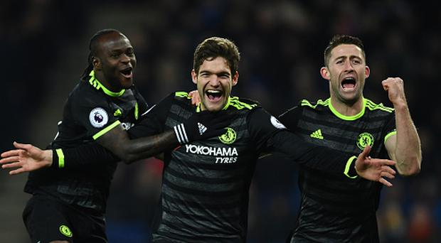 LEICESTER, ENGLAND - JANUARY 14: Marcos Alonso (C) of Chelsea celebrates with teammates Victor Moses (L) and Gary Cahill (R) after scoring his team's second goal during the Premier League match between Leicester City and Chelsea at The King Power Stadium on January 14, 2017 in Leicester, England. (Photo by Laurence Griffiths/Getty Images)