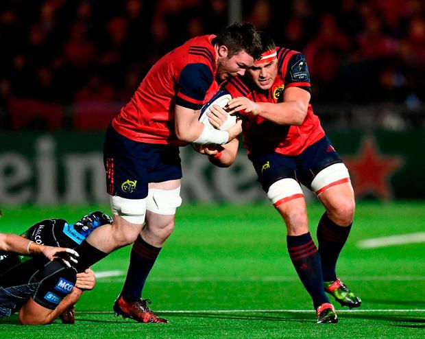 Peter O'Mahony with the support of his Munster team-mate CJ Stander. Photo: Stephen McCarthy/Sportsfile