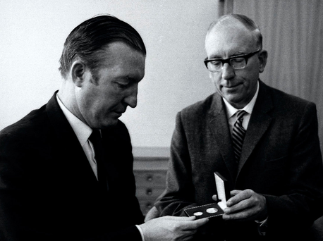 Then Finance Minister Charles Haughey is presented with the first of Ireland's new decimal coins by TK Whitaker, then governor of the Central Bank, in September 1969 Photo: Lensmen Photographic Agency
