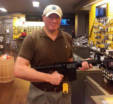 'I am holding a Bushmaster XM15. To buy, this would set me back $3,500 (€3,300), but I could get 250 rounds of ammunition as a special deal to purchase the gun'