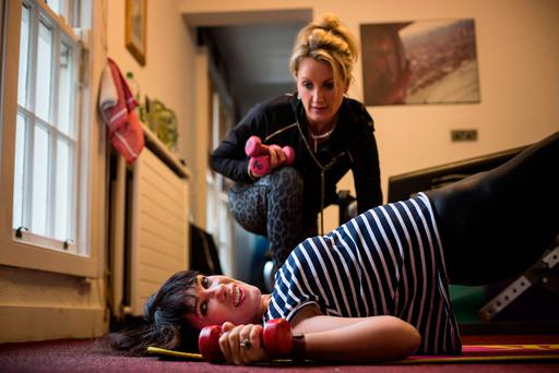Thrilled skinny: Victoria Mary Clarke working out with personal trainer Laura Gibson Photo: Mark Condren