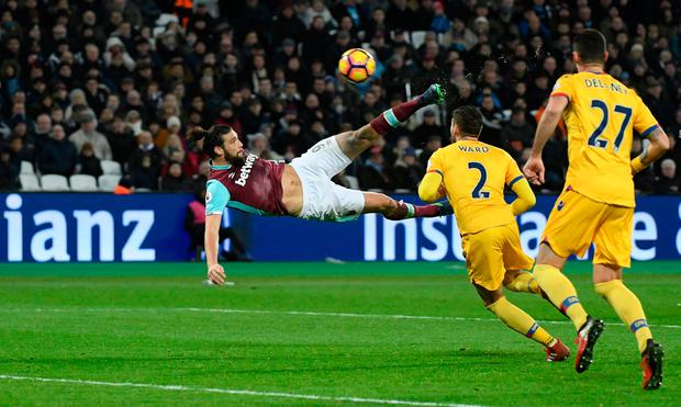 Andy Carroll scores the second goal Photo: Reuters