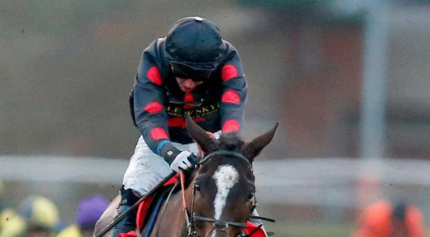 Derek Fox riding One For Arthur clears the last to win The Betfred Classic Handicap Steeple Chase. Photo: Getty