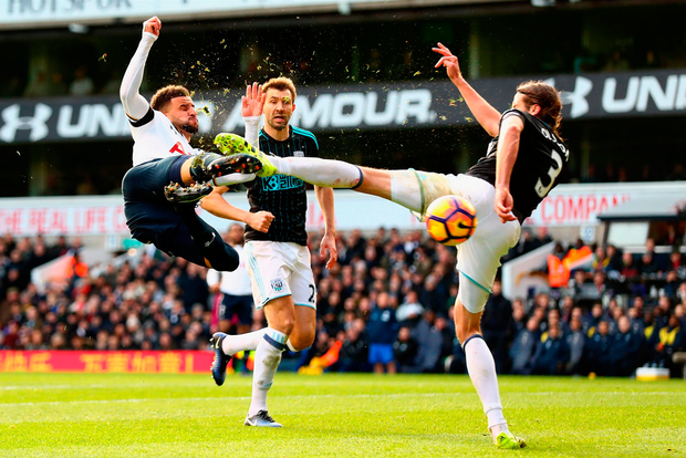 LONDON, ENGLAND - JANUARY 14: Kyle Walker of Tottenham Hotspur (L) volleys while Jonas Olsson of West Bromwich Albion (R) attempts to block during the Premier League match between Tottenham Hotspur and West Bromwich Albion at White Hart Lane on January 14, 2017 in London, England. (Photo by Clive Rose/Getty Images) ***BESTPIX***