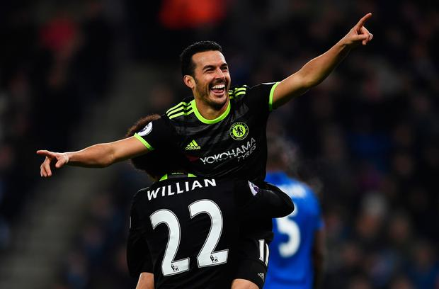 Pedro celebrates with Willian after scoring their team's third goal. Photo: Getty