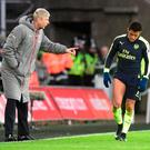 Wenger deals with Sanchez. Photo: Reuters