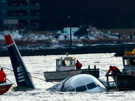 Rescue crews secure a US Airways flight 1549 floating in the water after it crashed into the Hudson River in 2009 Getty