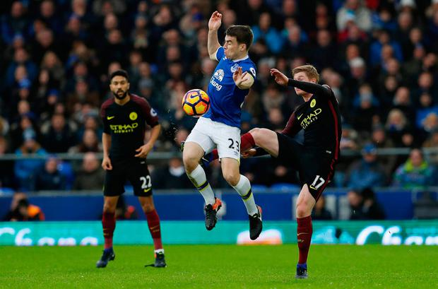 Everton's Seamus Coleman in action with Manchester City's Kevin De Bruyne
