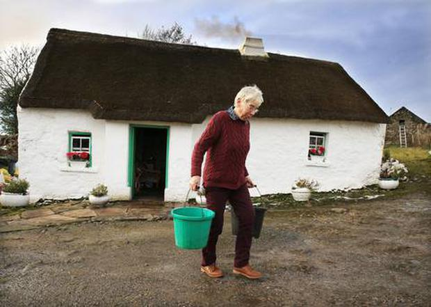 Margaret Gallagher in her thatched cottage in Belcoo