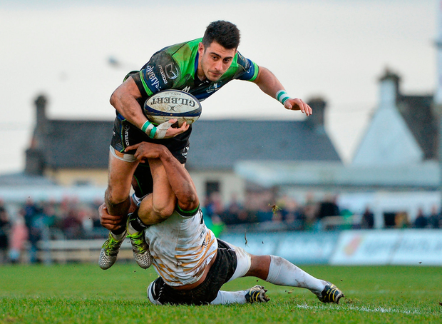 Tiernan O'Halloran tries to escape the clutches of Maxime Mbandà. Photo by Seb Daly/Sportsfile