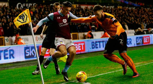 Matt Doherty battles it out with Aston Villa's Jack Grealish during last Friday's Championship match at Molineux. Photo: Reuters / Andrew Boyers