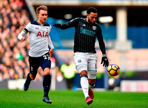 Tottenham Hotspur's Christian Eriksen (left) and West Bromwich Albion's Matt Phillips. Photo credit: Dominic Lipinski/PA Wire