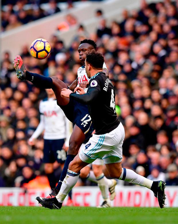 Tottenham Hotspur's Victor Wanyama (left) and West Bromwich Albion's Hal Robson-Kanu (right) battle for the ball. Photo credit: Dominic Lipinski/PA Wire