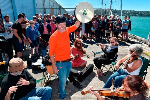 Enda O'Coineen with the Dunedin Scottish Fiddle Club at a farewell before sailing from Otago to Auckland. Photo: Otago Daily Times