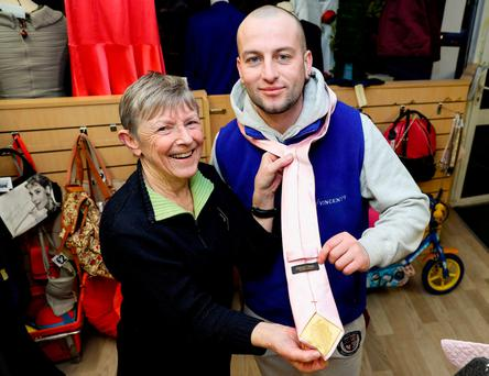 SVdP volunteers Mary Rafter and John Mc Keever with one of the Donald Trump ties. Photo: Maxpix