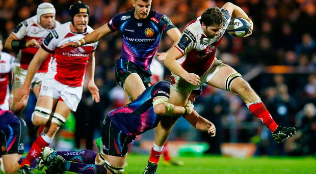 Exeter's Mitch Less tackles Ulster's Iain Henderson (R)