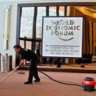 A man cleans the carpet in the building where the annual meeting of the World Economic Forum will take place in Davos, Switzerland, over the coming days. Photo: AP Photo/Michel Euler