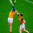 Antrim's John Dillon rises high into the air to make a fine fetch ahead of Kilkenny defender Michael Walsh during yesterday's Bórd na Mona Walsh Cup at Abbotstown in Dublin. Photo: Sportsfile