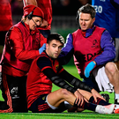 Conor Murray of Munster is treated for an injury. Photo by Stephen McCarthy/Sportsfile