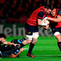 Peter O'Mahony with the support of his Munster team-mate CJ Stander is tackled by Josh Strauss and Ali Price, right, of Glasgow Warriors. Photo by Stephen McCarthy/Sportsfile