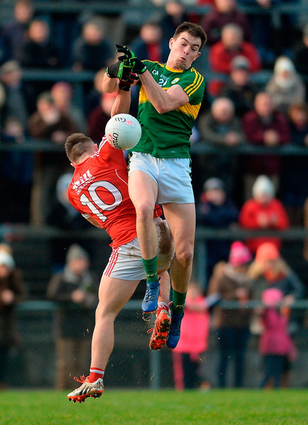 Kerry's Jack Barry spills the ball under pressure from Cork's Sean Powter. Photo: Sportsfile