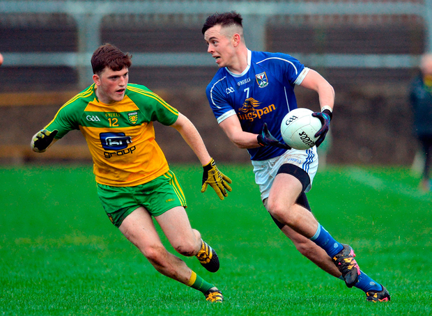 Gerard Smith of Cavan in action against Niall O'Donnell of Donegal. Photo: Sportsfile