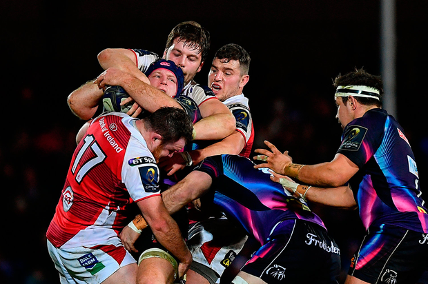 Thomas Waldrom of Exeter Chiefs is tackled by Ulster trio Andrew Warwick, left, Iain Henderson, centre, and Sean Reidy. Photo by Ramsey Cardy/Sportsfile