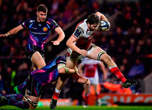 Iain Henderson of Ulster is tackled by Mitch Lees of Exeter Chiefs. Photo by Ramsey Cardy/Sportsfile