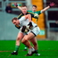 Kildare's Tommy Moolick is challenged by Offaly goalkeeper Alan Mulhall during their O'Byrne Cup clash at O'Connor Park in Tullamore. Photo: Sportsfile