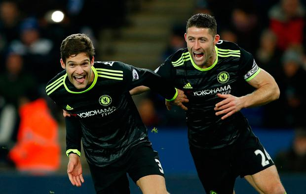Marcos Alonso celebrates with Gary Cahill after scoring Chelsea's second goal against Leicester. Photo: Reuters / John Sibley