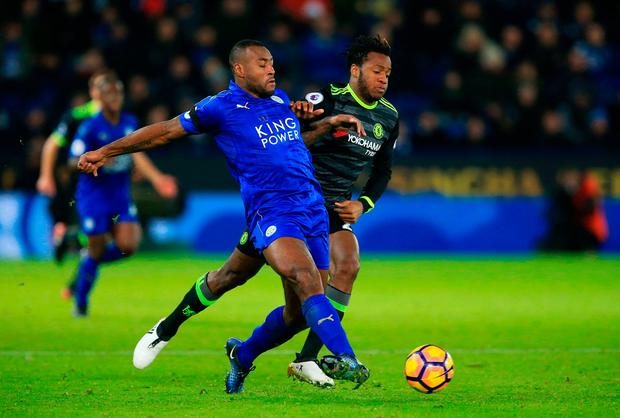 Leicester City's Wes Morgan (left) and Chelsea's Michy Batshuayi battle for the ball. Photo credit: Nigel French/PA Wire