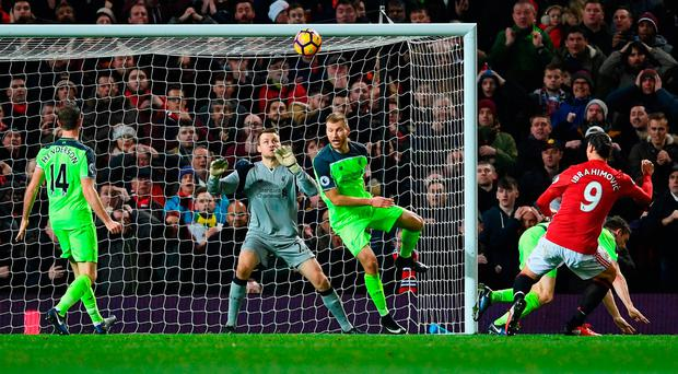 Zlatan Ibrahimovic stoops to score Manchester United's equaliser. Photo by Laurence Griffiths/Getty Images